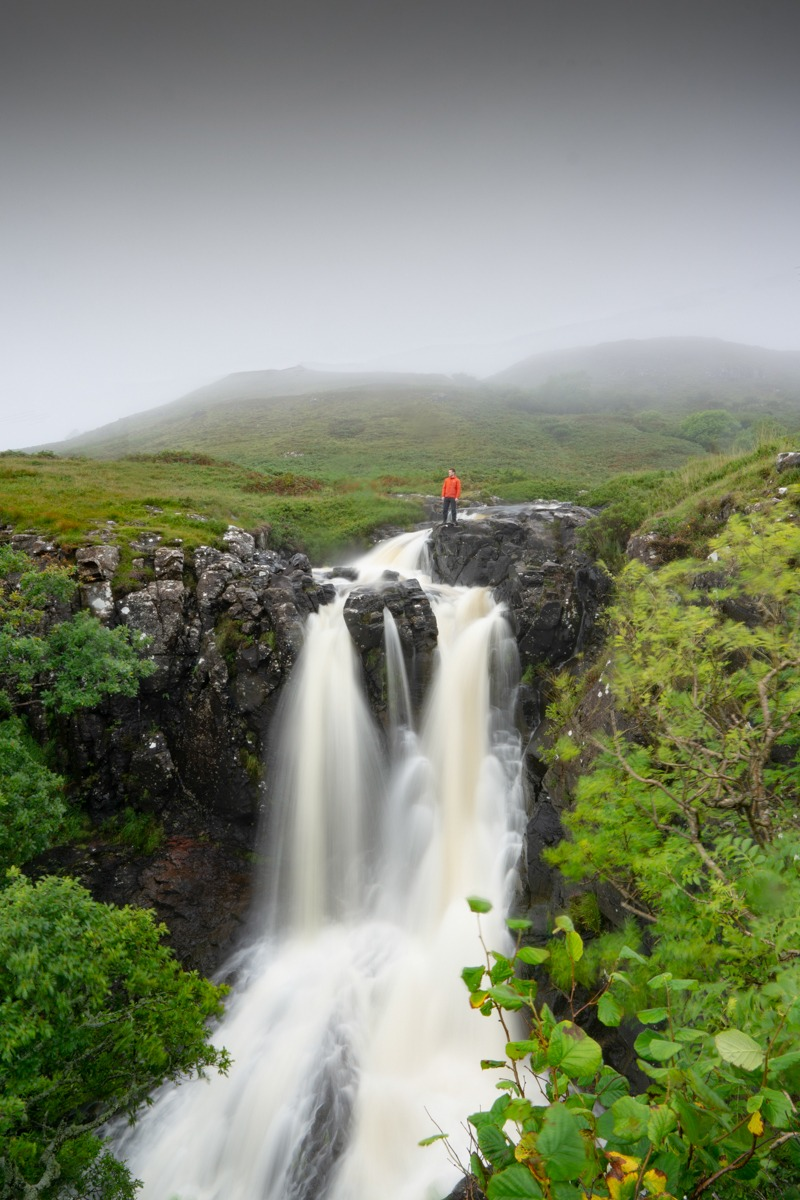Eas Fors waterfall with man stood at the top