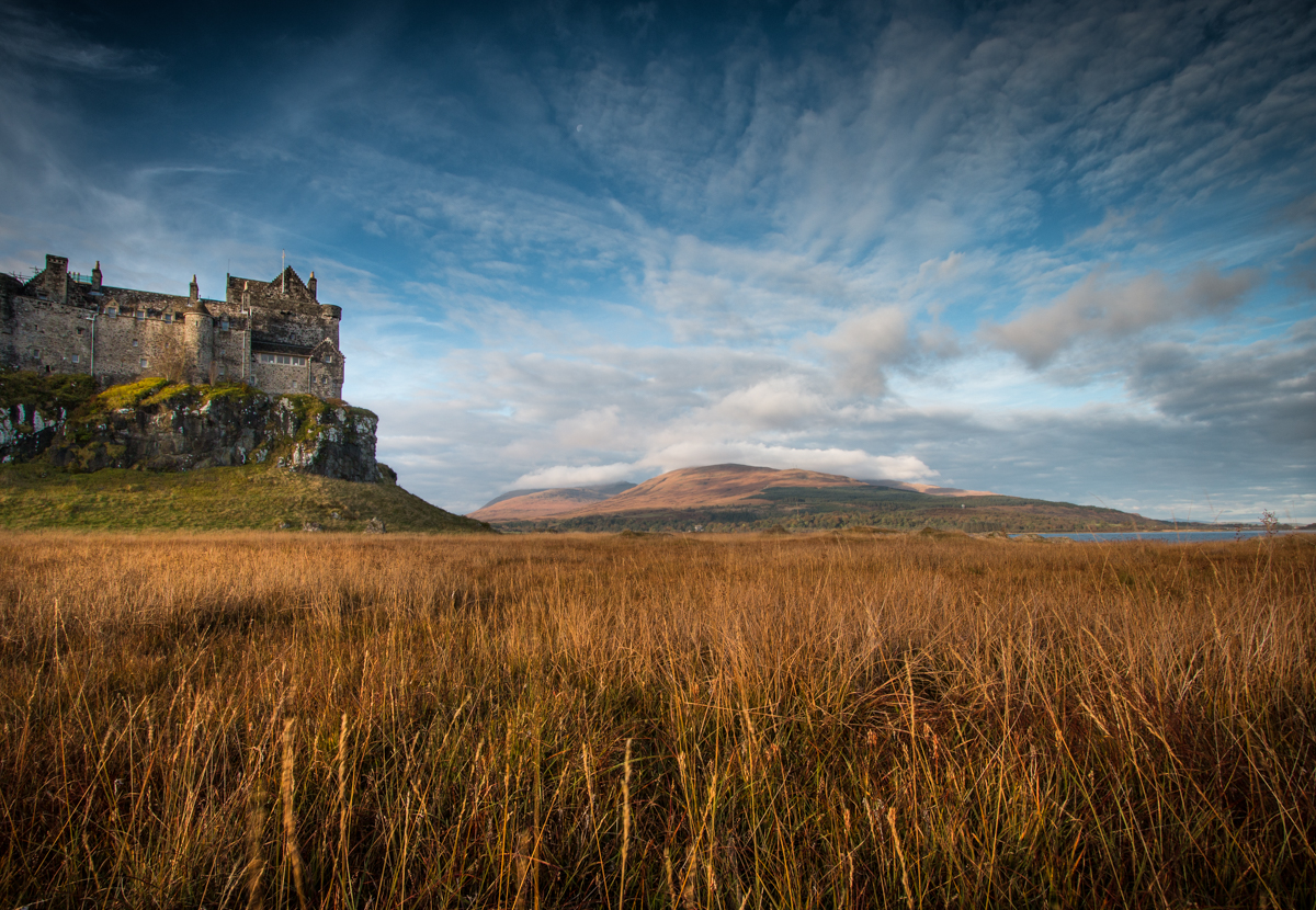 Duart Castle on the headland in south east Mull, surrounded by hills and fields in autumn