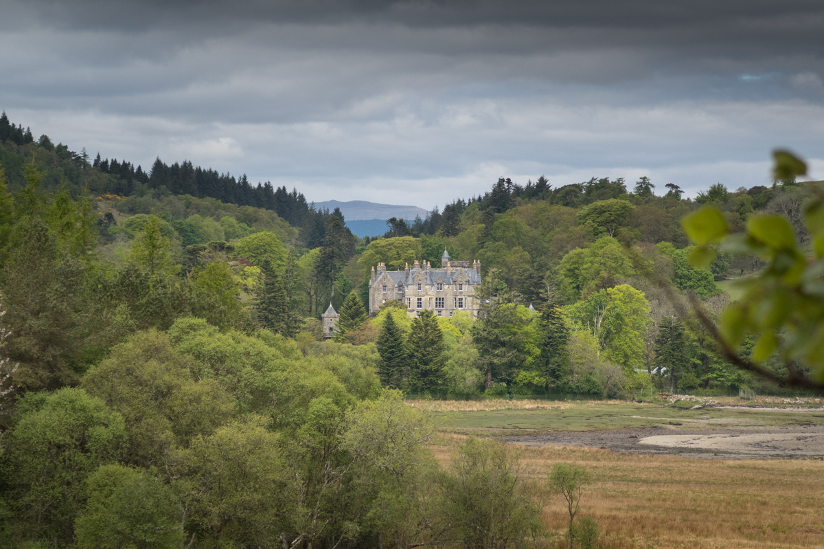 View to Torosay Castle surrounded by trees on the Isle of Mull