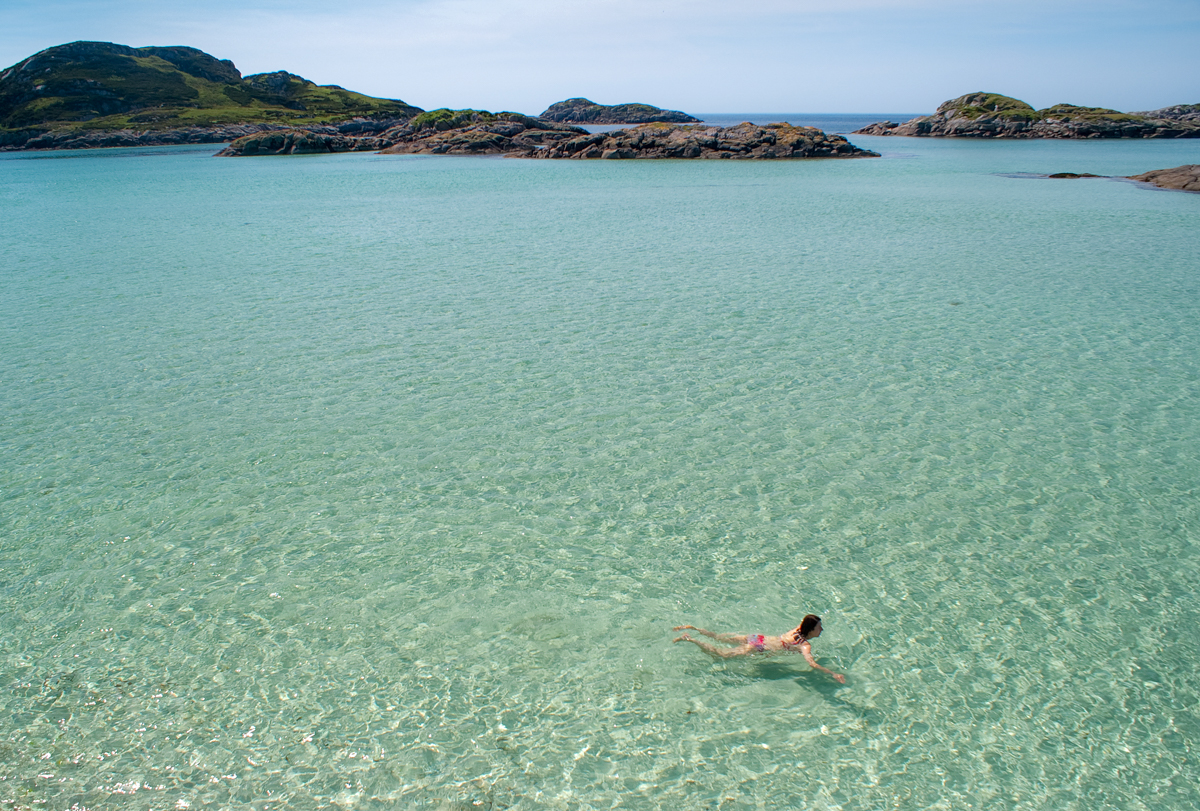 Swimming in clear turquoise waters at Knockvologan on the Ross of Mull
