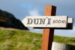 A sign for the walk up Dun I the highest point on Iona at 101 meters