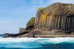 Staffa with the three rock layers; tuff bottom, columnar basalt middle and volcanic debris on top