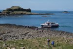 Visitors heading back to the boat across boulder beach on Lunga