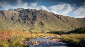 The Coladoir River as it flows through Glen More with Ben Buie behind