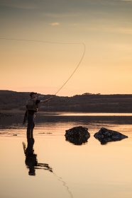 Fisherman working the high tide at Loch Cuin at sunset