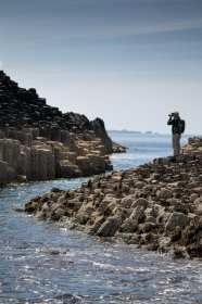 Man photographing Staffa