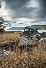An old boat at rest on the shore of Loch Scridain
