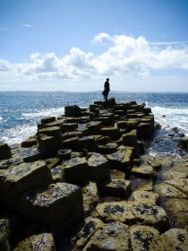 A person walking the basalt pavement on Staffa