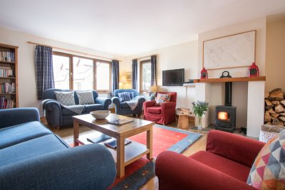 Living area with plenty of seating, cosy stove and lots of extras