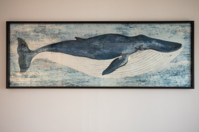 Nautical themed artworks add character to the cottage