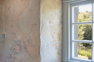 Exposed lime render walls and old beams