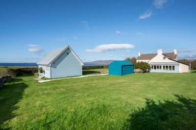 Balmeanach Farmhouse enjoys a private position within extensive gardens with a superb sea view