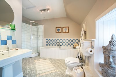 Enjoy the spacious Jack and Jill bathroom on the upper floor, serving the two double bedrooms upstairs