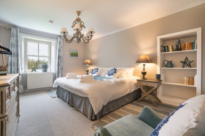 The ground floor double bedroom promises elegance, with private garden views