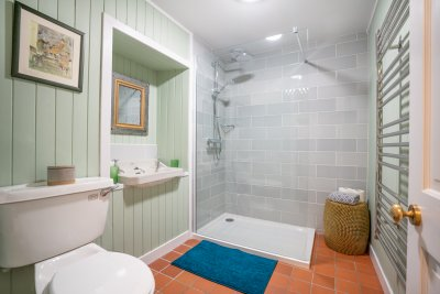 The spacious shower room on the ground floor lies a stone's throw from the ground floor bedroom