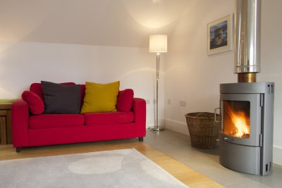 Sofa and woodburning stove
