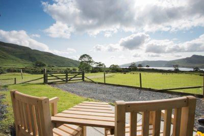 Garden with seating and sea views at the Bothy