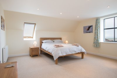The very large master double bedroom with sea views
