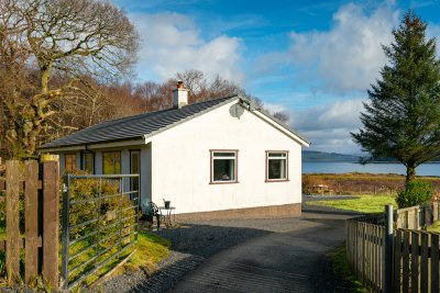 Arrive at Butterfly Cottage with plenty of parking and a stunning setting