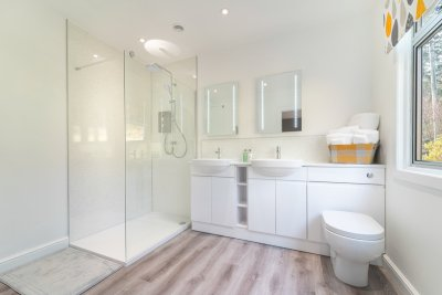 Indulge with a walk-in shower and twin basins in the twin bedroom en-suite