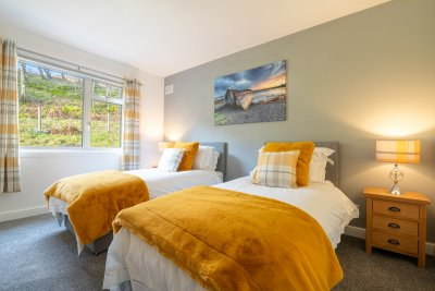 Doze off in the luxurious twin bedroom, complete with its own en-suite