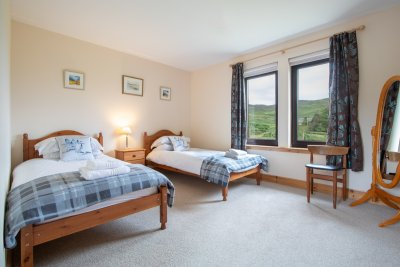 The second twin bedroom with built in wardrobes and glen views