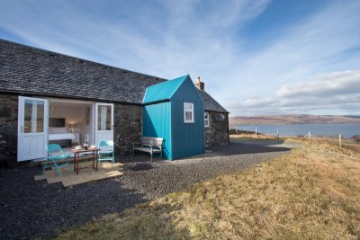 Cottage exterior.  Private setting with fenced garden and wonderful sea views