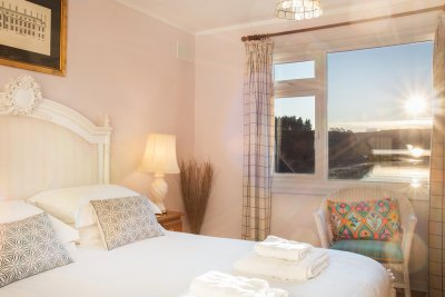 Wake up to a stunning sea view from the king-sized master bedroom