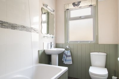 Family bathroom with bath, shower over, basin and w.c.
