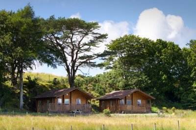 Eas and Fors Lodge setting with mature trees providing backdrop and shelter