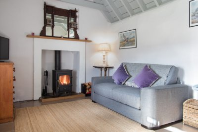 Wood burning stove in the cottage with fuel provided