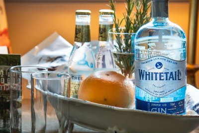 Enjoy a complimentary bottle of Whitetail Gin