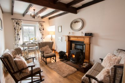 Wooden beams in the dining and sitting room with wood burning stove