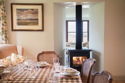 Get cosy by the stove at mealtimes