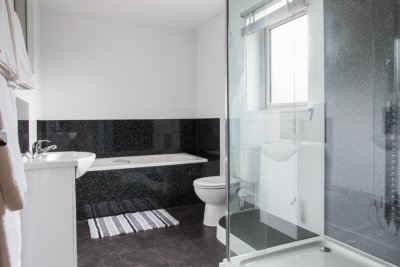 Family bathroom with large shower unit, bath and basin