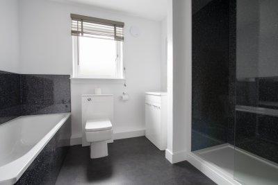Contemporary bathroom with bath and separate shower unit