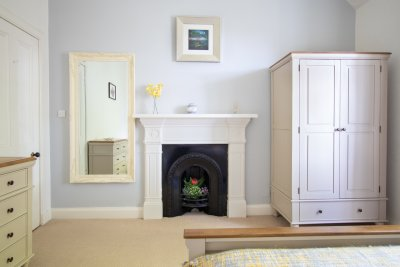 Ample storage in the twin bedroom and feature fireplace