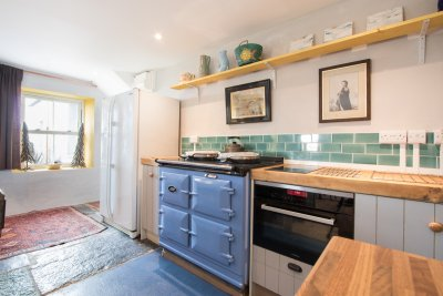 Aga creates focal point to the kitchen and plenty of warmth too