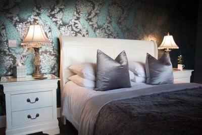 Opulent furnishings and bed linen in the master bedroom