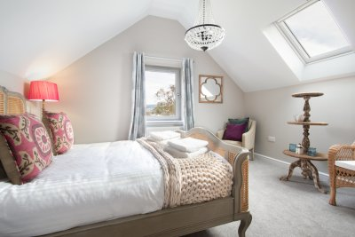 Vaulted ceilings add character and an airy feel to the bedrooms