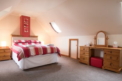 Master double bedroom with dressing table and plenty of storage