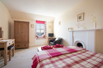 Spacious double bedroom with great views over the harbour