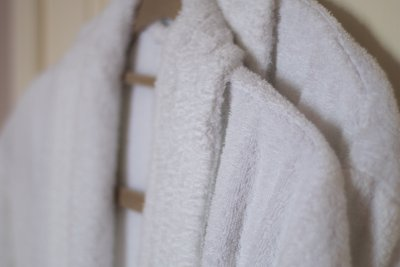 Towelling robes and mules provided for guests