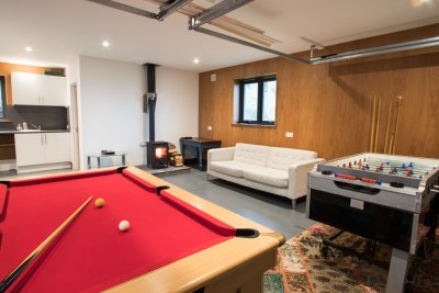 Superb games room with wood burning stove and seating area