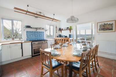 Sunny kitchen with dining table is a great place for families to eat and play games