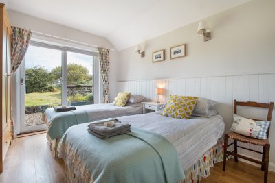 The twin bedroom is beautifully decorated with blankets woven close by
