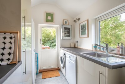 The well equipped utility room promises home-from-home amenities