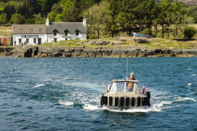The Ulva ferry with the Boathouse on Ulva in the background