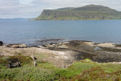 The rocky coast around Ardtun with Ardmeanach visible across Loch Scridain