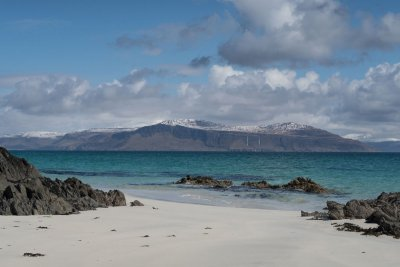 Traigh Bhan in north Iona and the winters view across to the snow clad Isle of Mull